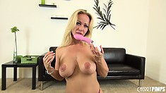 Busty Austin takes off her top, titty fucks her dildo and gets on the floor
