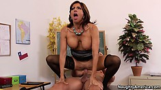Tara jumps on top of her student and rides his big dick all over her desk