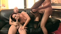Wonderful redhead in sexy black lingerie enjoys a double penetration on the couch