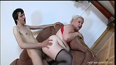 Chubby old blonde bitch gets fucked by a young man on her couch