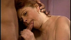 Redheaded granny gets banged and titfucked by a young schlong