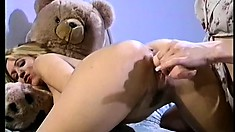 Kinky blonde coed takes a sexy babe down with a big strap-on