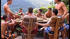 A tropical island filled with a lot of sexy muscular men walking around