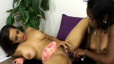 Two ebony lesbians have the time of their lives with a strap-on dildo