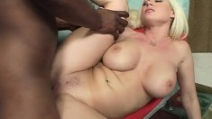 A massive black cock explores the pussy of a busty blonde babe
