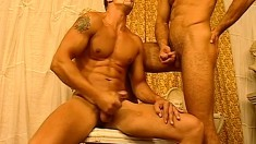 A big group of muscled guys come together to please each other's poles