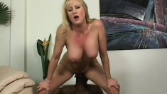 Busty blonde cougar reveals how much she loves to fuck a big black cock