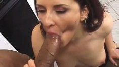 Voluptuous white cocksucker plays with a black stud's enormous dick