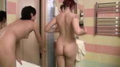 Brunette and redhead lesbian teens having intense sex in the bathtub