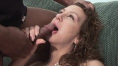 Hung black dude gets his massive prick sucked by a horny white chick