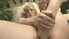 Big breasted housewife Adajja fucks a huge dildo and rides the sybian
