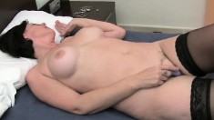 Sexy MILF Julie wears her nylons while she fingers her hairy bush