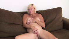 Kinky blonde mature Sabine shows off her body and fingers her snatch