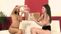 Two fascinating brunettes having fun with hot piss and big sex toys