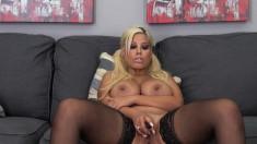 Bodacious blonde in black stockings Bridgette masturbates on the couch