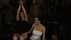 Brunette hung up in the dungeon gets fucked over and toyed by mistress