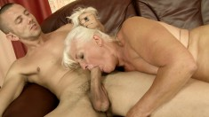 Big breasted blonde cougar Judi gets fucked hard by a young stallion