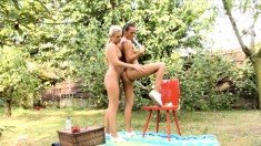 Blonde and brunette beauties devour each other's pussies in the garden