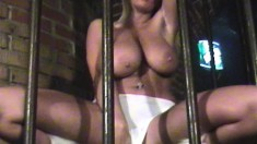 Stacked and sultry vixen Ines strokes her hot pussy in a New Year's cage dance
