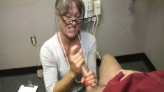 Slutty mature lady with glasses Leilani jerks off a big pole to orgasm