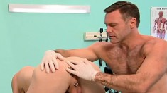 Fascinating hunk welcomes a fist up his butt in the doctor's office