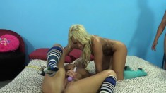 Tanned blondes Britney Amber and Cali Carter engage in a hot threesome