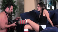 Hot brunette domme in striped stockings tramples a bound slave's balls