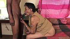 Young guy stuffing his massive long cock into chocolate granny's hole