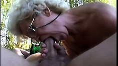 Sagging granny keeps her glasses on while banging in the woods