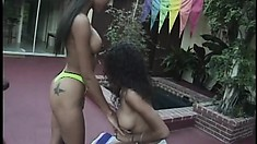 Three ebony babes catch all the lesbian action by the pool, on camera
