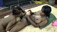 Naughty black bitches make each other moan with their big toys