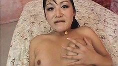 Tiny Asian eye candy spreads her legs to get her tight hole drilled