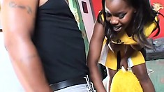 Ebony cheerleader shows off her body and takes a huge black cock deep in her twat