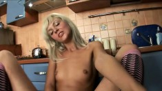 Sweet young Cathy inserts a big banana in her tight wet snatch