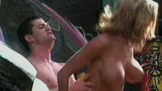 Cop targets a hot, busty whore in the back alley and pounds her hardcore