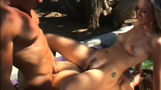 Two charming blonde milfs get their wet holes banged hard by a stud in the outdoors