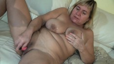 Fat granny with big tits masturbates and then chews on his pecker