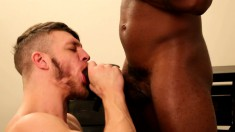 Two gay leather lovers indulge in an exciting interracial experience