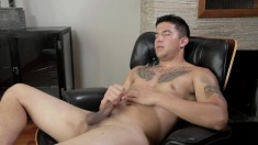 Inked young Joey Rico enjoys stroking his own massive cum gun