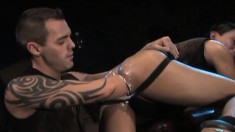 Tattooed hunk jams his fist deep in an Asian stud's lubed ass