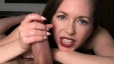 Busty MILF jerks and teases an extra large cock