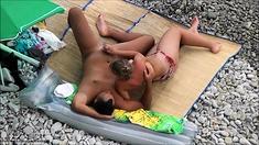 Huge Cumshot As Milf Gives Incredible Beach Handjob